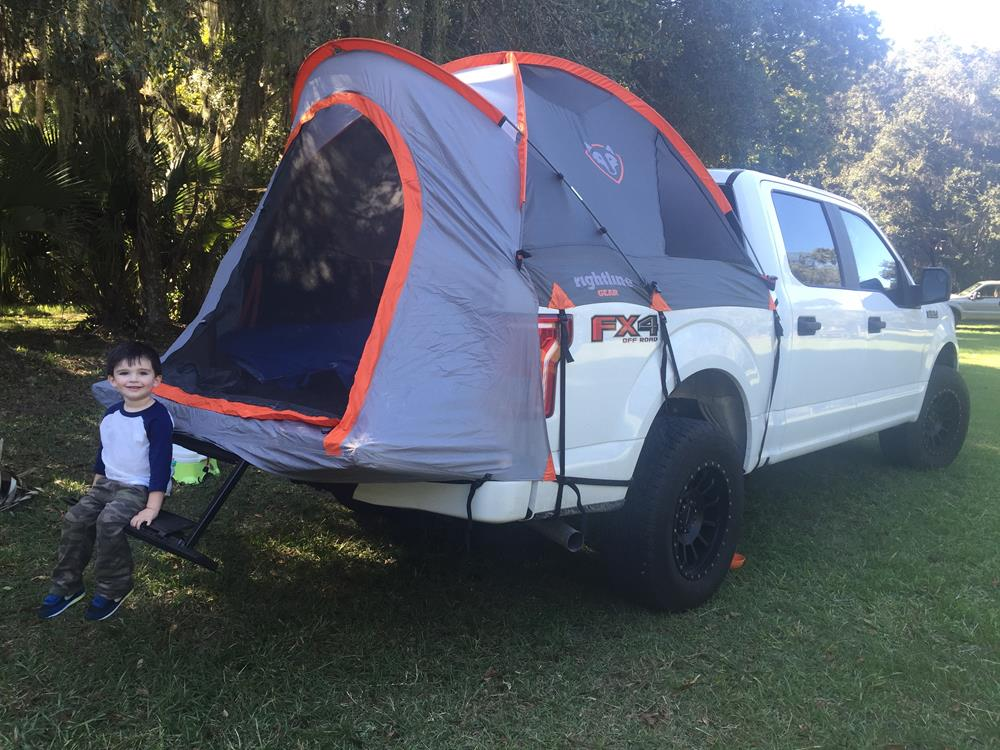 You can see that our customer is using the tailgate step on his Ford. The tailgate portion of the truck tent fits around the step without a problem. & Ford F150 | Tailgate Step | Truck Tent | Rightline Gear